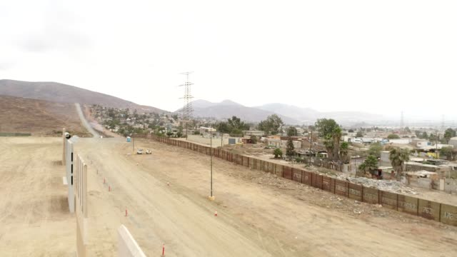 light-tan prototype u.s. mexico border wall stands in this aerial footage taken over san diego, california, u.s., on monday, oct. 30, 2017.... - pair of compasses stock videos & royalty-free footage