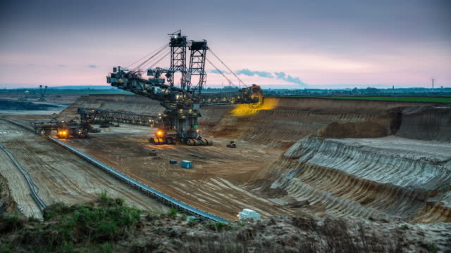 lignite mine with bucket wheel excavator - time lapse tracking shot - earth mover stock videos & royalty-free footage