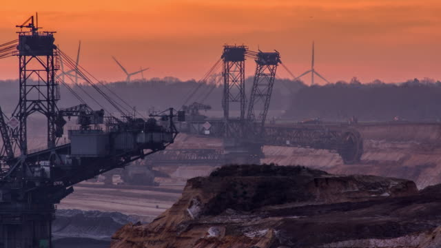 lignite surface mine with two large bucket wheel excavators - land mine stock videos and b-roll footage