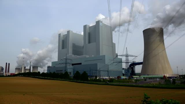 lignite-fired power plant neurathopen brown coal pit garzweiler, grevenbroich, north rhine westphalia, germany - fossil fuel stock videos & royalty-free footage