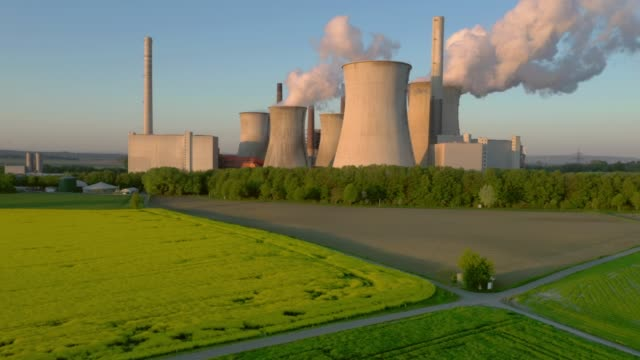 lignite-fired power station at sunrise - verkehrsweg stock-videos und b-roll-filmmaterial