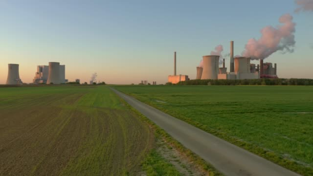 lignite-fired power stations at sunrise - social issues点の映像素材/bロール