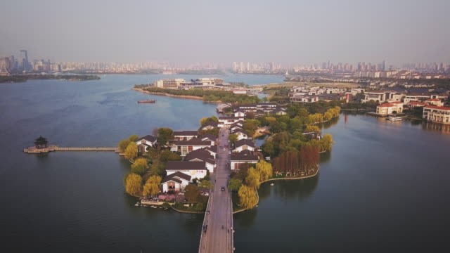 aerial ws ligongdi street across jinji lake, suzhou, jiangsu province, china - east china stock videos & royalty-free footage