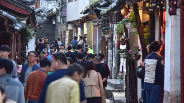 lijiang old town with crowd tourist, china. - folk music stock videos and b-roll footage