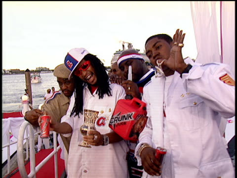 Lil Jon the East Side Boyz and Lil Scrappy posing for pictures at the 2004 MTV Video Music Awards red carpet Lil Jon shows off his cup