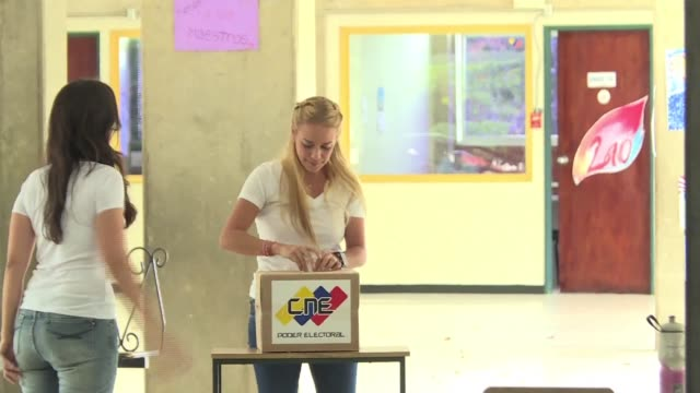 lilian tintori the wife of a jailed opposition leader and a high profile critic of maduro voted sunday in caracas calling on the government to accept... - critic stock videos & royalty-free footage