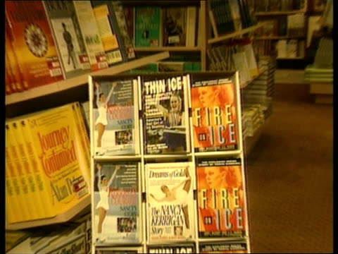 tonya harding and nancy kerrigan compete amid attack controversy norway lillehammer stand of paperback books zoom in books on both kerrigan and... - paperback stock videos & royalty-free footage
