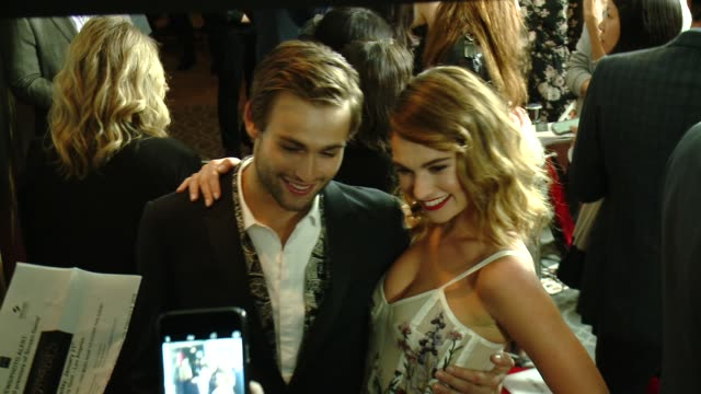 Lily James and Douglas Booth at the 'Pride And Prejudice And Zombies' Los Angeles Premiere at Harmony Gold Theater on January 21 2016 in Los Angeles...
