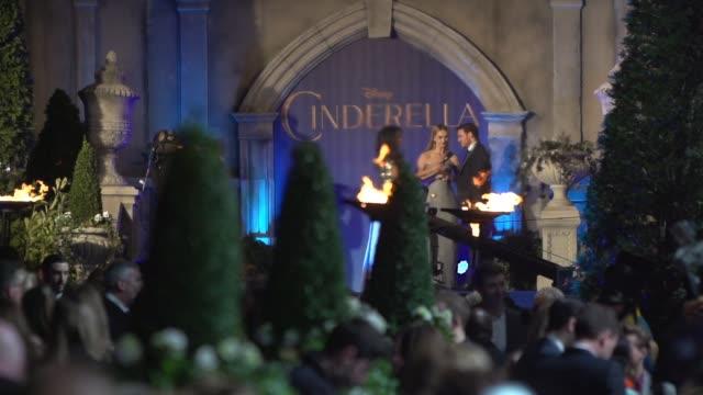 lily james, richard madden at 'cinderella' uk premiere on march 19, 2015 in london, england. - シンデレラ点の映像素材/bロール