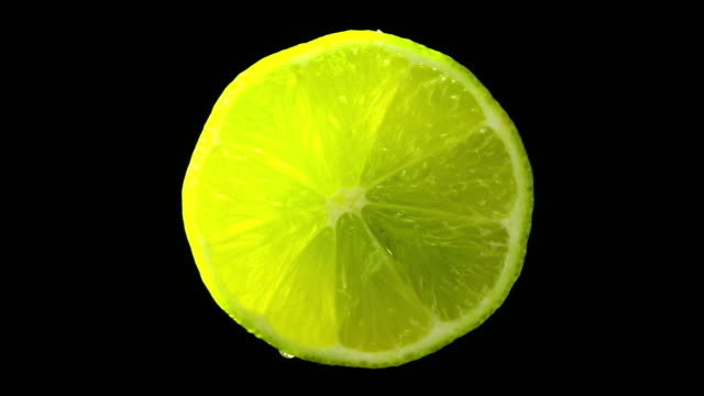 lime fruit slowly rotating with black background - tropical fruit stock videos & royalty-free footage