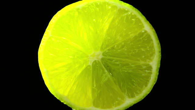 lime fruit zoom in slowly with black background - lime stock videos and b-roll footage