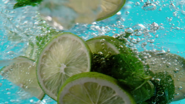 lime, mint and ice fall into the water - antioxidant stock videos & royalty-free footage