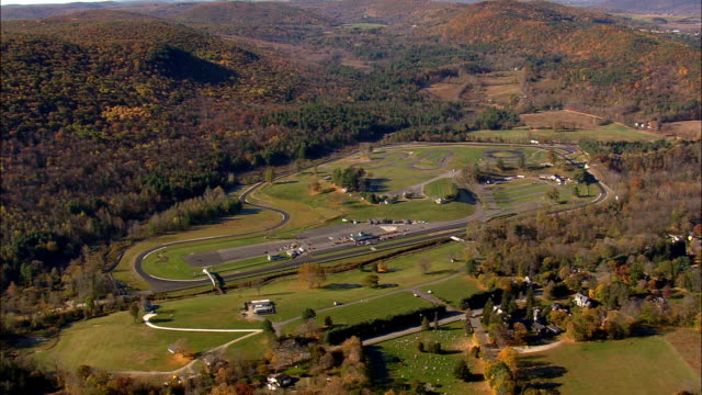 lime rock park and raceway  - aerial view - connecticut,  litchfield county,  united states - rocking stock videos & royalty-free footage
