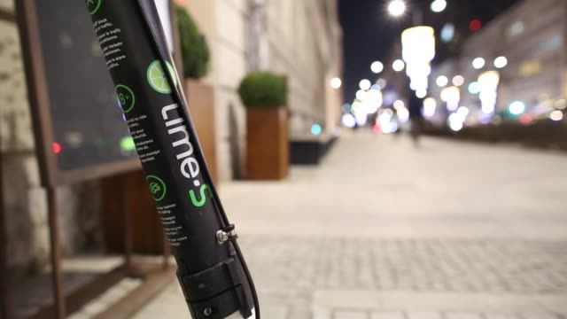 a lime scooter is seen is seen in warsaw poland on january 24 2018 the scooters can be used with the lime ride sharing app and have recently become... - lime stock videos & royalty-free footage