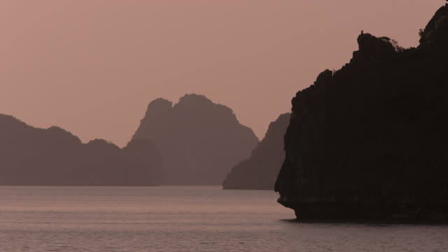 ws lime stone cliffs in ha long bay / vietnam - halong bay stock videos and b-roll footage