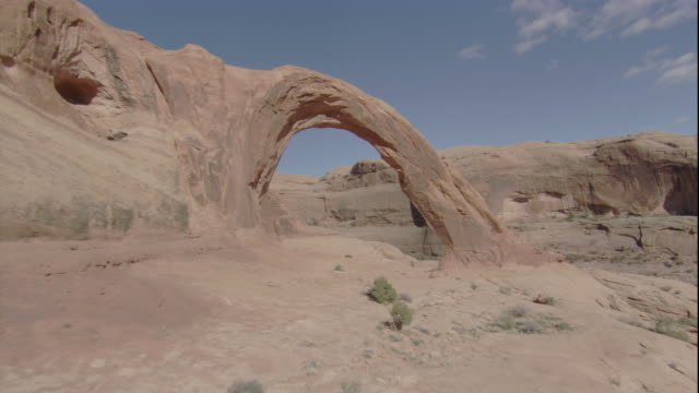 A limestone arch casts a shadow in the Utah desert. Available in HD.