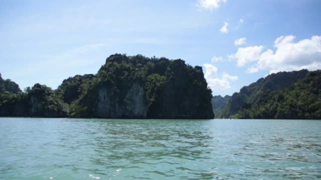 ts limestone formation in the ocean, langkawi, malaysia - langkawi stock videos and b-roll footage