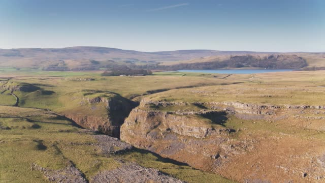 limestone pavement and malham tarn - drone shot - rolling landscape stock videos & royalty-free footage