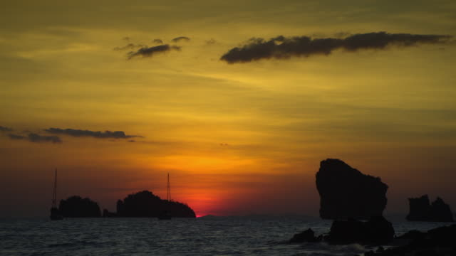 ws limestone pinnacles in sea at sunset, krabi, thailand - see other clips from this shoot 1459 stock videos and b-roll footage