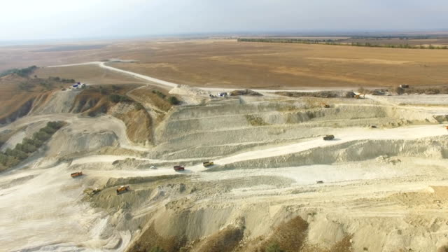 aerial: limestone quarry near road construction - limestone stock videos and b-roll footage