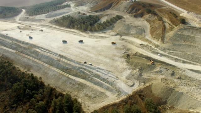 aerial: limestone quarry near road construction - limestone stock videos & royalty-free footage
