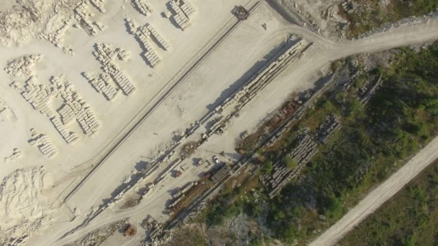 AERIAL: Limestone quarry on mountain plateau