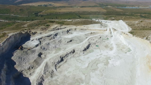 aerial: limestone quarry - marble rock stock videos and b-roll footage