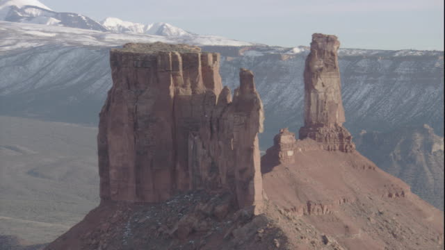limestone rock formations tower over a snow-dusted canyon in utah. available in hd. - mesa stock videos and b-roll footage