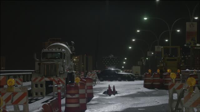 ls limo parked behind road barricades / los angeles, california, united states - バリケード点の映像素材/bロール