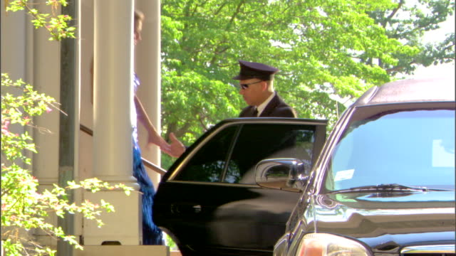 limousine driver helping elegant couple - see other clips from this shoot 1277 stock videos and b-roll footage