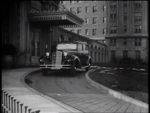 b/w 1935 limousine driving away from hotel / newsreel - 1935 stock videos & royalty-free footage