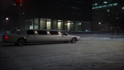 ws pan limousine driving through downtown at night / manhattan, new york, usa - limousine stock videos & royalty-free footage
