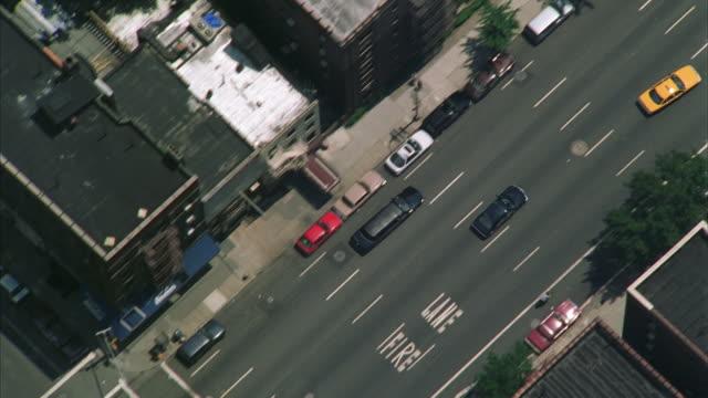 aerial ws ts limousine driving through town / manhattan, new york, usa - limousine stock videos & royalty-free footage
