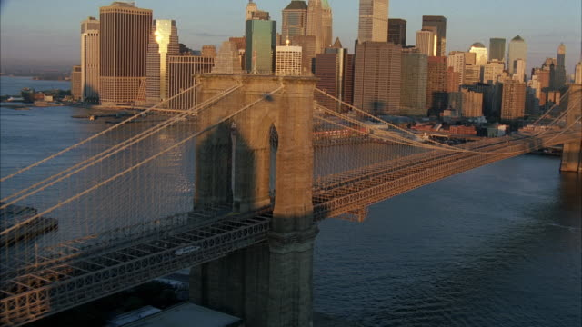 AERIAL WS TS Limousine Speeding On Brooklyn Bridge, With Cityscape / New York City, New York, USA