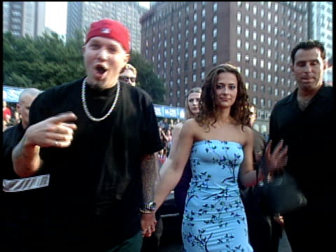 limp bizkit arriving on the red carpet at the 1999 mtv video music awards fred durst speaking to the camera and wes borland sticking his tongue out - mtv1 stock-videos und b-roll-filmmaterial