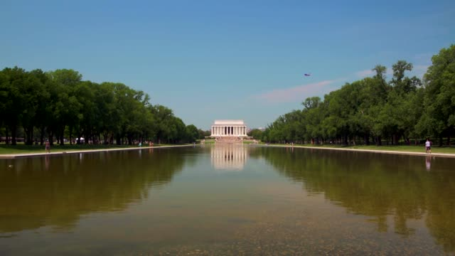 Lincoln Memorial and Reflecting Pool with Jet Passing in Washington, DC