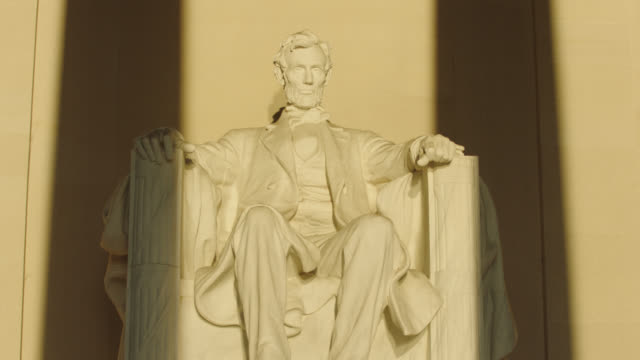 lincoln memorial statue lit by early morning sunlight - abraham lincoln stock videos & royalty-free footage