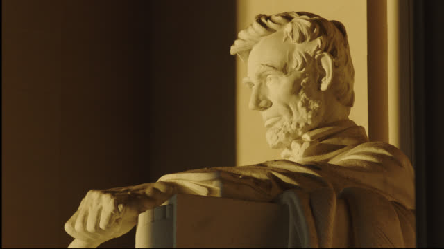 lincoln memorial statue lit by early sunlight - statue stock videos & royalty-free footage