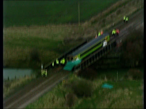 lincolnshire nr sleaford helpringham fen police around local train on bridge where it came to a stop after hitting a van at a level crossing killing... - fen stock videos and b-roll footage