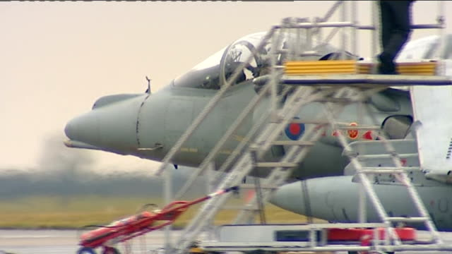 lincolnshire: raf cottesmore: ext harrier jump jet taxiing along as pilot waves from cockpit harrier jets taking off as flying along - lincolnshire stock videos & royalty-free footage