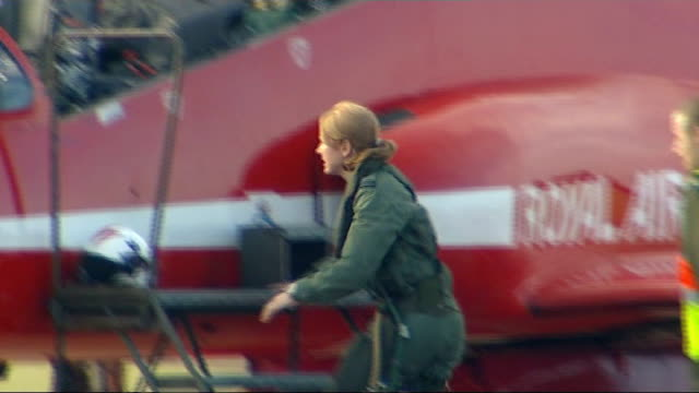 stockvideo's en b-roll-footage met lincolnshire: raf scampton: ext royal air force aerobatic team, the red arrows, flying overhead in formation various shots of flight lieutenant... - pilot