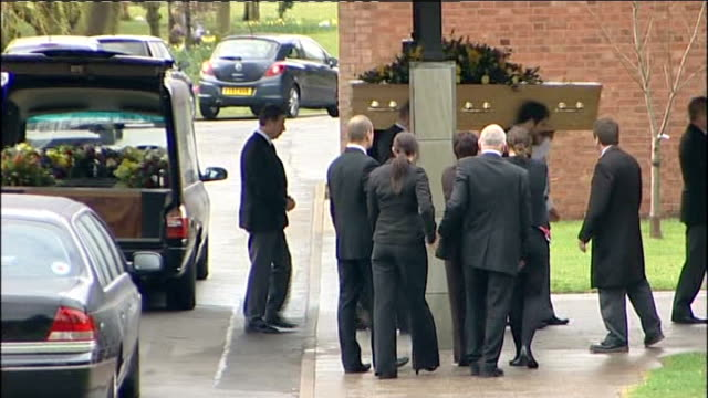 lincolnshire scunthorpe ext pallbearers carrying coffin of nicholas smith into crematorium followed by mourners - pompe funebri video stock e b–roll