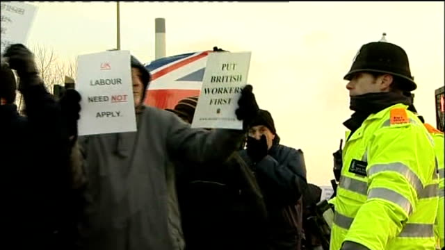 stockvideo's en b-roll-footage met lincolshire lindsey oil refinery ext protestors marching with flags and banners in support of 650 workers sacked by total - harder