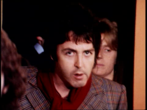 linda mccartney linda mccartney granada lib 1970s paul in check jacket towards and past followed by linda who kisses camera with rest of group wings - paul mccartney stock videos and b-roll footage