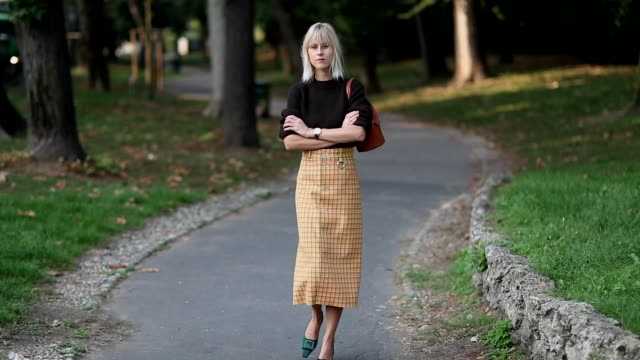 linda tol wearing knit, checked yellow midi skirt is seen outside tods during milan fashion week spring/summer 2019 on september 21, 2018 in milan,... - checked pattern stock videos & royalty-free footage