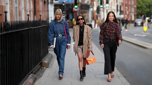 linda tol wearing overall, chloe harrouche wearing leopard cycle pants and erika boldrin wearing cropped denim jeans is seen outside jw anderson... - dungarees stock videos & royalty-free footage