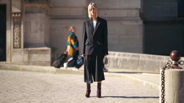 stockvideo's en b-roll-footage met linda tol wears a checked blazer jacket, a white top, flared pants, burgundy leather shoes, outside maison margiela, during paris fashion week... - blazer