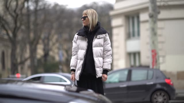 linda tol wears a white puffer coat a black dress sunglasses a gray bag sneakers during paris fashion week womenswear fall/winter 2018/2019 on march... - black dress stock videos & royalty-free footage