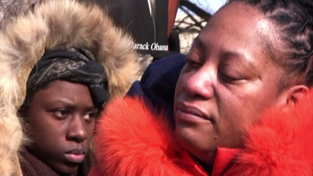 Linda Walker of Bayshore New York reacts while listening on Pennsylvania Avenue as Barack Obama the first black president of the United States of...