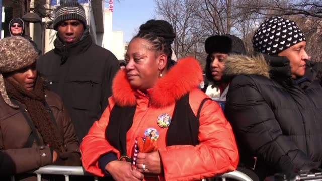 Linda Walker of Bayshore New York waits on Pennsylvania Avenue for Barack Obama the first black president of the United States of America to be sworn...